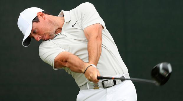 Tough test: Rory McIlroy tees off at the fourth