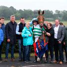 Hoop hooray: Downpatrick winner Hillary John and jockey Gavin Sheehan with members of the horse's Up The Hoops syndicate of owners