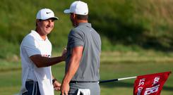 Caddy Ricky Elliott (left) celebrates with Brooks Koepka after winning the US Open