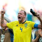 Sweden captain Andreas Granqvist celebrates their win over South Korea