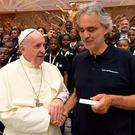 Pope Francis and tenor Andrea Bocelli at a previous concert featuring children from Haiti
