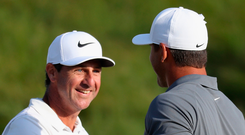 Dynamic duo: Portrush's Ricky Elliott congratulates Brooks Koepka