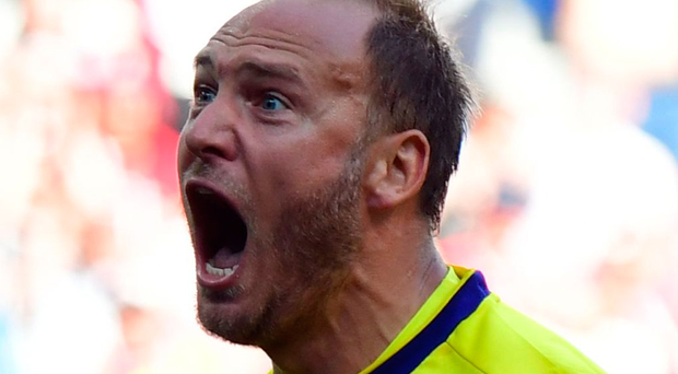 Spot on: Andreas Granqvist celebrates scoring a penalty