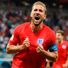 Victory roar: Harry Kane shows his delight after heading home a late winner for England against Tunisia in their World Cup opener