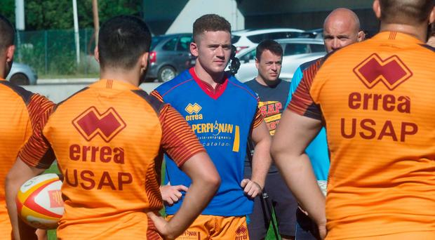 Perpignan's Irish flyhalf Paddy Jackson (C), former Ulster player, takes part in a training session with teammates on June 19, 2018 in Perpignan, southwestern France. / AFP PHOTO / RAYMOND ROIGRAYMOND ROIG/AFP/Getty Images