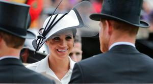 Prince Harry (R) and Meghan, Duchess of Sussex arrive on day one of the Royal Ascot horse racing meet, in Ascot, west of London, on June 19, 2018. AFP PHOTO / Daniel LEAL-OLIVASDANIEL LEAL-OLIVAS/AFP/Getty Images