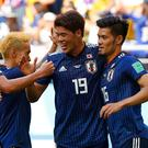 Japan celebrate their win over Colombia