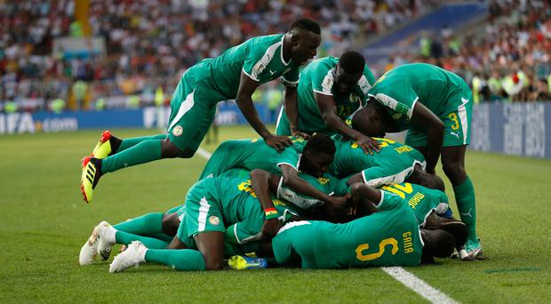 Senegal celebrate their second goal