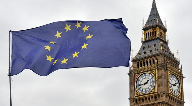 File photo dated 29/03/17 of an EU flag flying in front of the Houses of Parliament in London (Victoria Jones/PA)