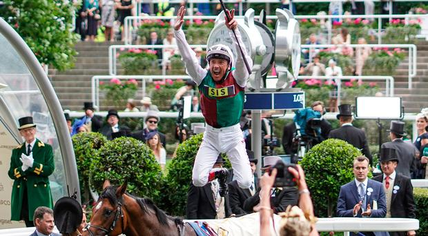 Jump for joy: Frankie Dettori celebrates winning the St James's Palace Stakes on Without Parole