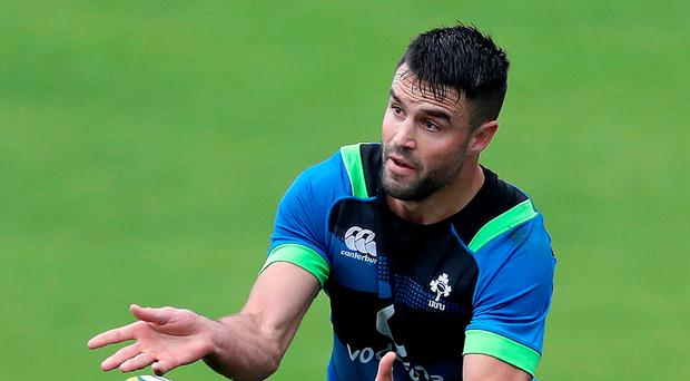 On the ball: Conor Murray in action at Ireland's training session at North Sydney Oval yesterday