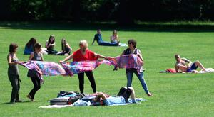 People entertain themselves in the afternoon sunshine at Botanic Gardens in Belfast earlier this month
