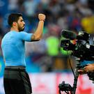 Luis Suarez fired Uruguay into the last-16
