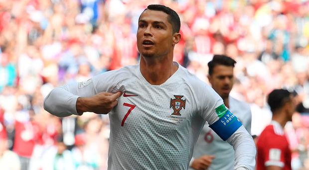 Portugal's forward Cristiano Ronaldo celebrates his opening goal for Portugal during the Russia 2018 World Cup Group B football match between Portugal and Morocco at the Luzhniki Stadium in Moscow on June 20, 2018. / AFP PHOTO / Francisco LEONG / RESTRICTED TO EDITORIAL USE - NO MOBILE PUSH ALERTS/DOWNLOADSFRANCISCO LEONG/AFP/Getty Images
