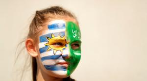 ROSTOV-ON-DON, RUSSIA - JUNE 20: A Uruguay fan enjoys the pre match atmosphere prior to the 2018 FIFA World Cup Russia group A match between Uruguay and Saudi Arabia at Rostov Arena on June 20, 2018 in Rostov-on-Don, Russia. (Photo by Ryan Pierse/Getty Images)