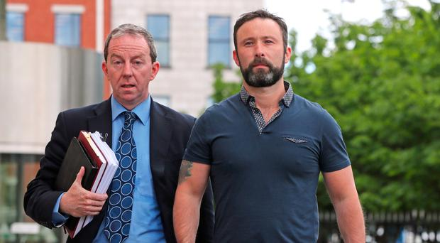 Damien McLaughlin walks free Belfast Crown Court with solicitor Peter Corrigan (left)
