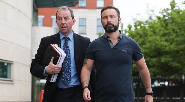 Solicitor Peter Corrigan with his client Damien McLaughlin outside Laganside Court in Belfast (Niall Carson/PA)