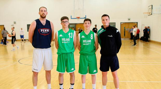 Tall order: Ireland seniors Aidan Quinn and Keelan Cairns, far right, with Under-16 players Connor McDonald and CJ Fulton