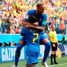 Clincher: Neymar celebrates with Douglas Costa after netting Brazil's second goal of the day