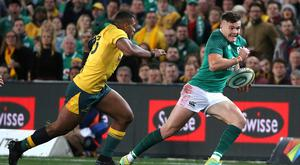 Ireland and Ulster's Jacob Stockdale, right, runs past Australia's Samu Kerevi during their rugby union test match in Sydney, Saturday, June 23, 2018. (AP Photo/Rick Rycroft)