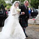 Rose Leslie with her father Sebastian Leslie arrive at Rayne Church, Kirkton of Rayne in Aberdeenshire, for her wedding (Jane Barlow/PA)