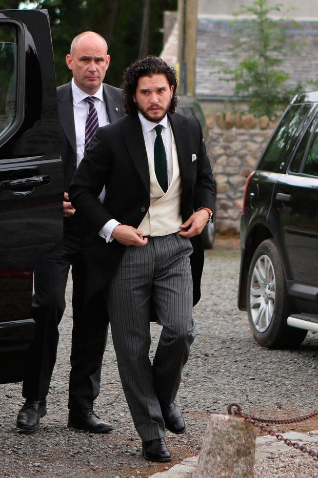 Groom Game of Thrones star Kit Harington, who plays Jon Snow, arriving at Rayne Church in the village of Kirkton of Rayne, Aberdeenshire, for his wedding ceremony with his co-star Rose Leslie, who played Ygritte in the drama. Pic: Jane Barlow/PA Wire