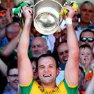 Donegal's Michael Murphy lifts the cup. Mandatory Credit ©INPHO/James Crombie