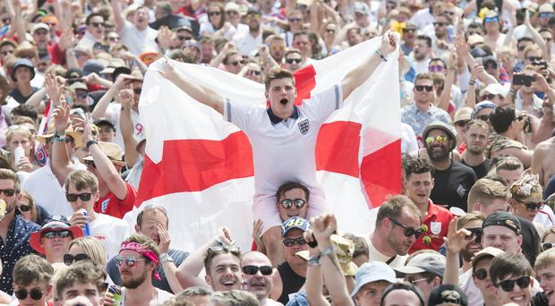 England supporters and festival goers watch England v Panama (David Jensen/PA)
