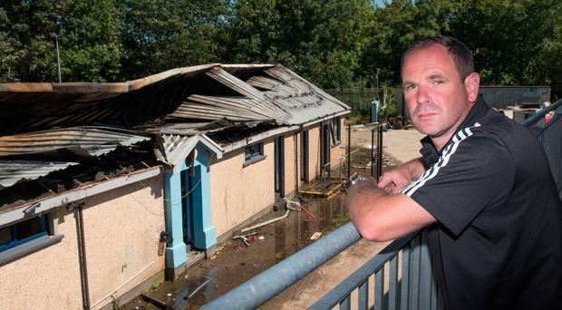 Institute vice-chairman Andrew Russell surveys the extensiv damage at the club's changing rooms caused by a weekend arson attack