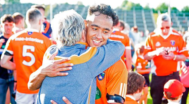 Winning feeling: Armagh's Jemar Hall celebrates with fan