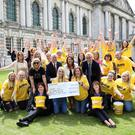 Ulster Bank colleagues reveal the total amount raised from the Bank's One Week in June fundraising activities in support of AWARE.