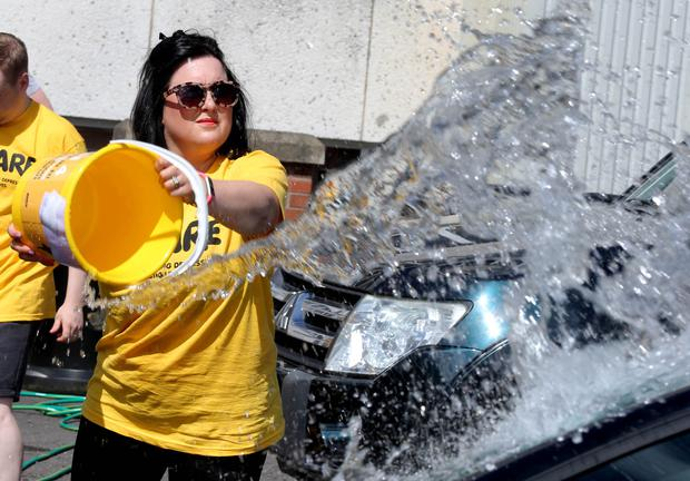 Ulster Bank colleagues took part in a charity car wash to raise money for AWARE.