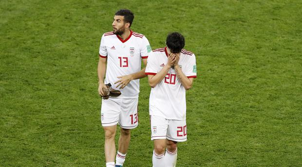 Iran came so close to knocking out Portugal (Darko Bandic/AP)