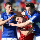 Marching orders: Cavan's Conor Moynagh saw red after this scuffle following the win over Down