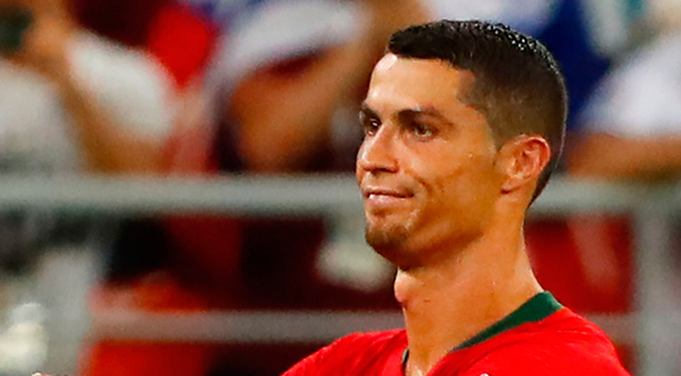 High drama: Cristiano Ronaldo gives his thoughts as Iran are awarded a dubious penalty via VAR