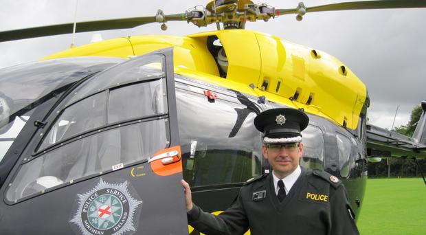 Police Service of Northern Ireland's Assistant Chief Constable Drew Harris unveiling the force's new helicopter (David Young/PA)