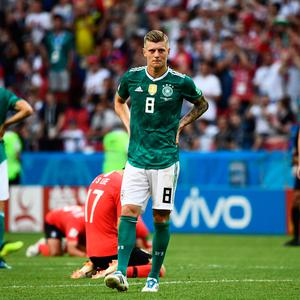 World of difference: Toni Kroos shows his disbelief as Germany exit the World Cup