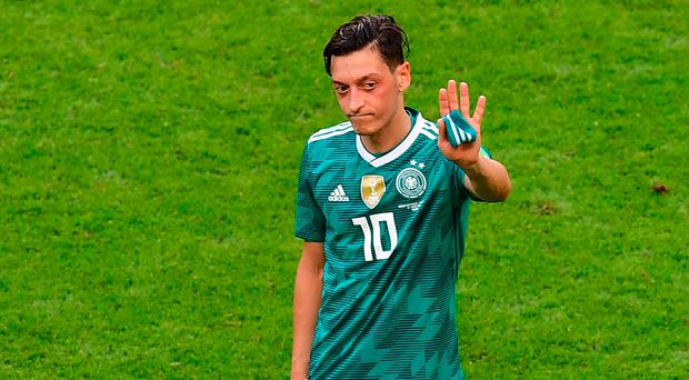 Wave farewell: Mesut Ozil has greatly under-performed
