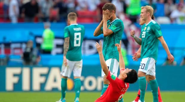 All over: Thomas Muller is devastated as Germany exit following defeat to South Korea in Kazan