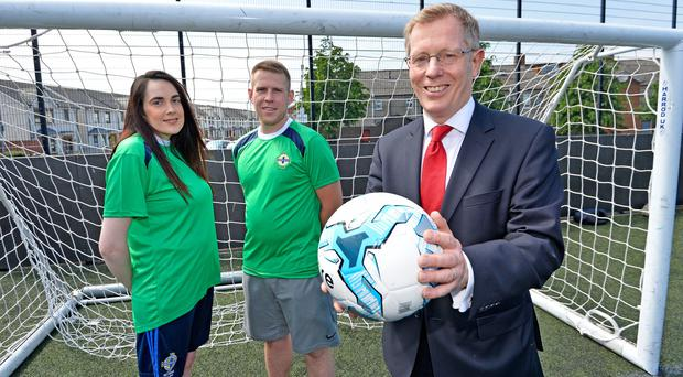 Pictured with Co-Ownership Chief Executive Mark Graham (right) are Street Soccer NI participants Catrina Sheehan and Gavin Martin.