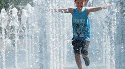 Declan Meighan cools down during the hot weather in Belfast on Thursday, that is thought to be the hottest day of the year, as the sunshine continues. Pic Colm Lenaghan/Pacemaker