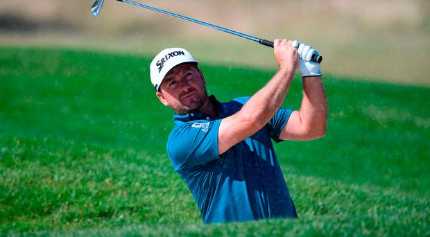 Strong start: Graeme McDowell is one off the early lead