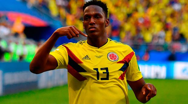 Hard luck: Defender Yerry Mina celebrates after scoring