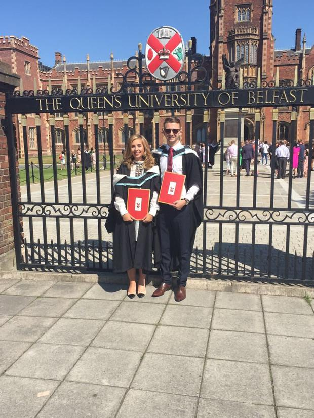 Laura Leydon and Conor McCashin outside Queen's on their graduation day.