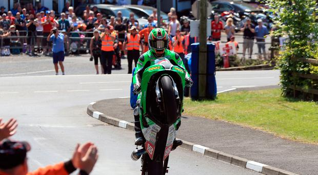 Number one: Derek McGee celebrates winning the first Open race