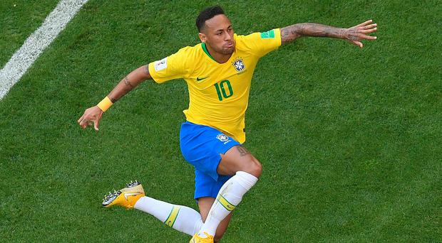 Brazil's forward Neymar celebrates scoring against Mexico.
