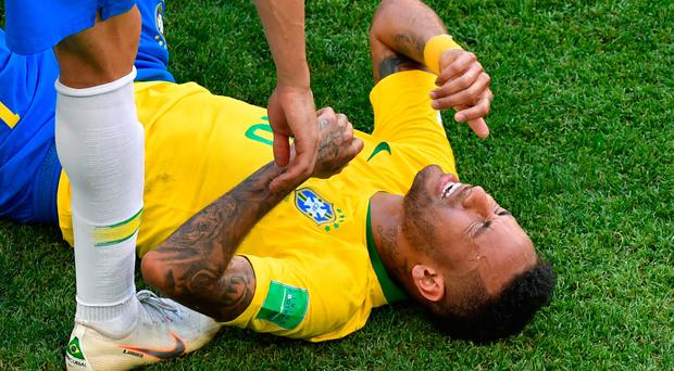 Brazil's forward Neymar reacts as he receives treatment during his side's win over Mexico.
