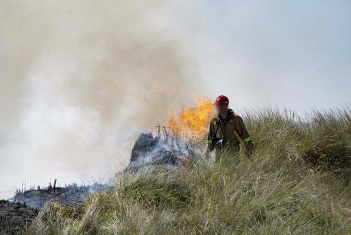 Firefighters tackle blaze at Benone beach. Pic Eoin McConnell.