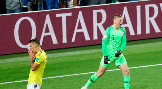 Jordan Pickford of England celebrates after Mateus Uribe of Colombia misses his side's fourth penalty in the penalty shoot out during the 2018 FIFA World Cup Russia Round of 16 match between Colombia and England at Spartak Stadium on July 3, 2018 in Moscow, Russia. (Photo by Alex Morton/Getty Images)