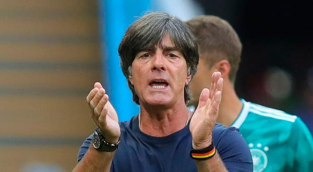 Staying on: Joachim Low will remain as boss of Germany despite their early World Cup exit